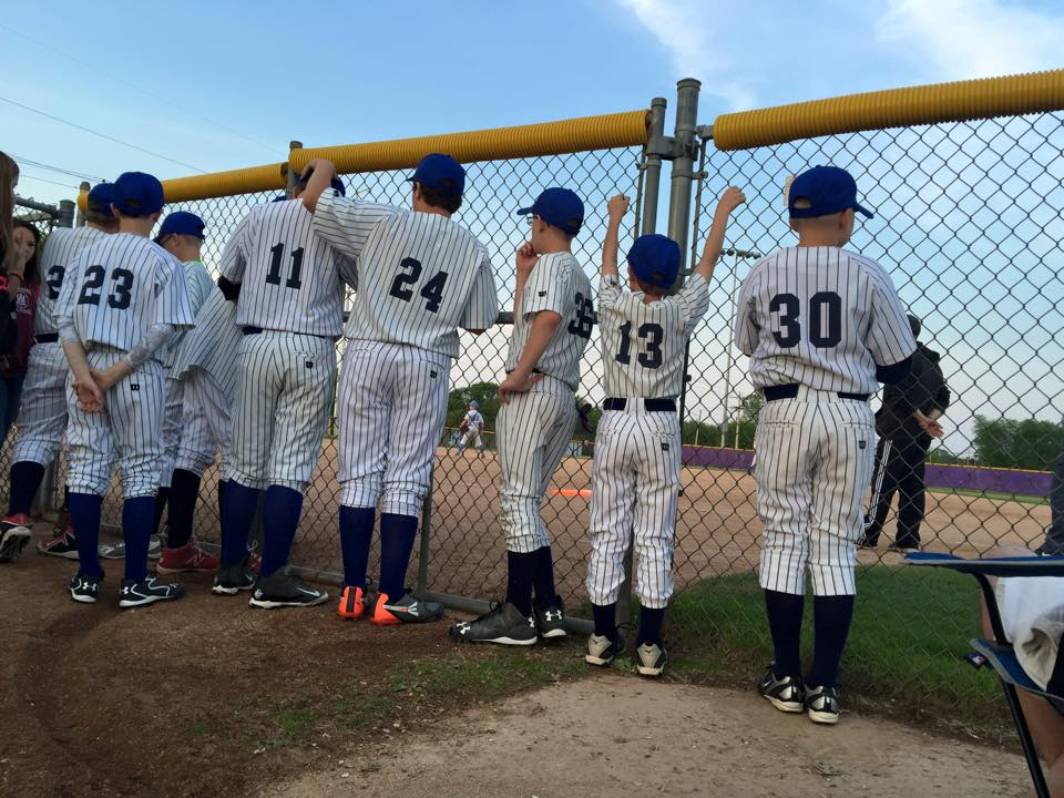 Youth Baseball Players at the Fence