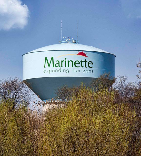Marinette water tower with trees below